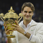 Roger Federer of Switzerland holds the winners trophy after defeating Andy Murray of Britain in their men's final tennis match at the Wimbledon Tennis Championships in London